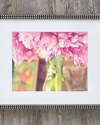 pink peonies in glass milk bottle in silver frame with square mouldings
