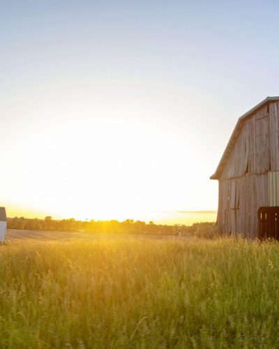 rustic decor barn photo of two barns in Kentucky at sunse