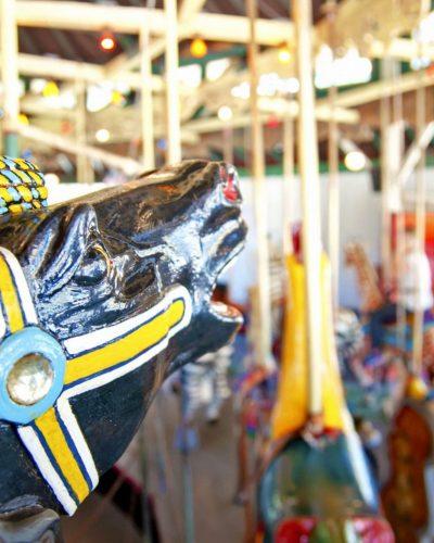 black merry go round horse yellow bridle photo