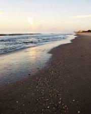 beach at dawn in cocoa beach looking down the shoreline