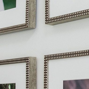 silver frame corners of mounted wall art